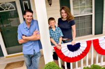 image shows family on porch